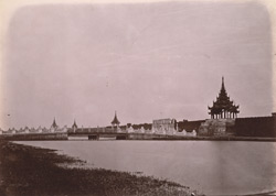 View of the moat looking towards the city bridge and gate, Mandalay